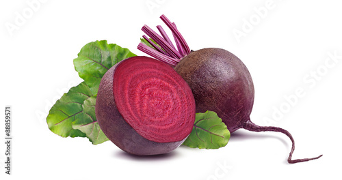 Whole beet root and half isolated on white background