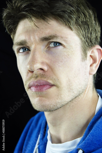 Headshot Of A Young Man With Blue Eyes Brown Hair Giving Attitude