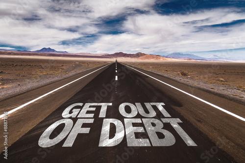 Photo Get Out of Debt written on desert road
