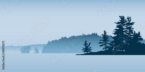 Spoed Foto op Canvas Blauwe hemel Misty silhouette of the landscape of a northern lake with pine forest and isalnds.