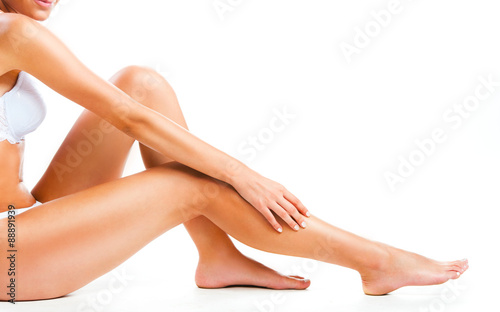 Fotografie, Obraz  Woman legs isolated on white background