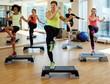 Multiracial group during aerobics class