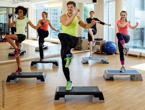 Fotografie, Obraz  Multiracial group during aerobics class