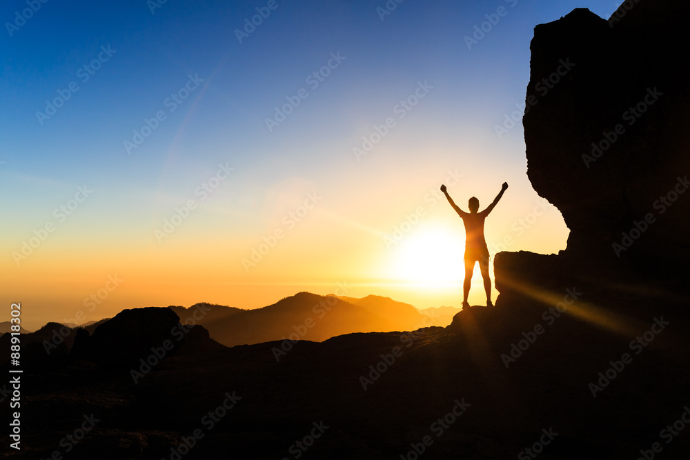Fototapeta Woman climber success silhouette in mountains, ocean and sunset