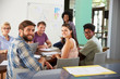 Portrait Of Staff At Brainstorming Meeting In Office