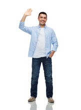 Smiling Man Waving Hand
