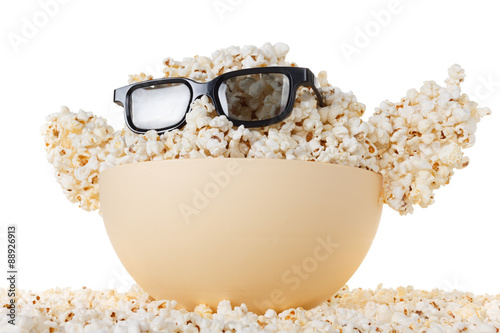 Photo Smiling happy Monster of popcorn, glasses. Isolated on white
