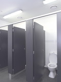 Row of toilet cubicles in a pristine industrial lavatory, Melbourne, Australia 2015