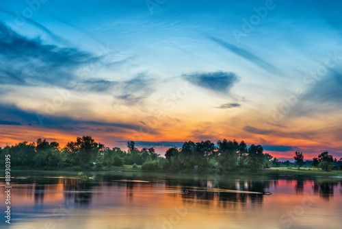 Foto auf Gartenposter Fluss Beautiful sunset above a big river