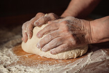 Senior Woman Hands Knead Dough...