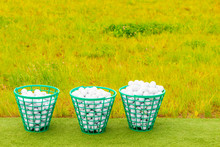 Three Baskets Filled With Golf...