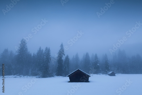 Misty winter morning on alpine countryside