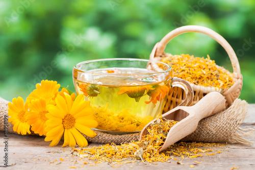Fotografie, Obraz  Cup of healthy marigold tea and calendula flowers.
