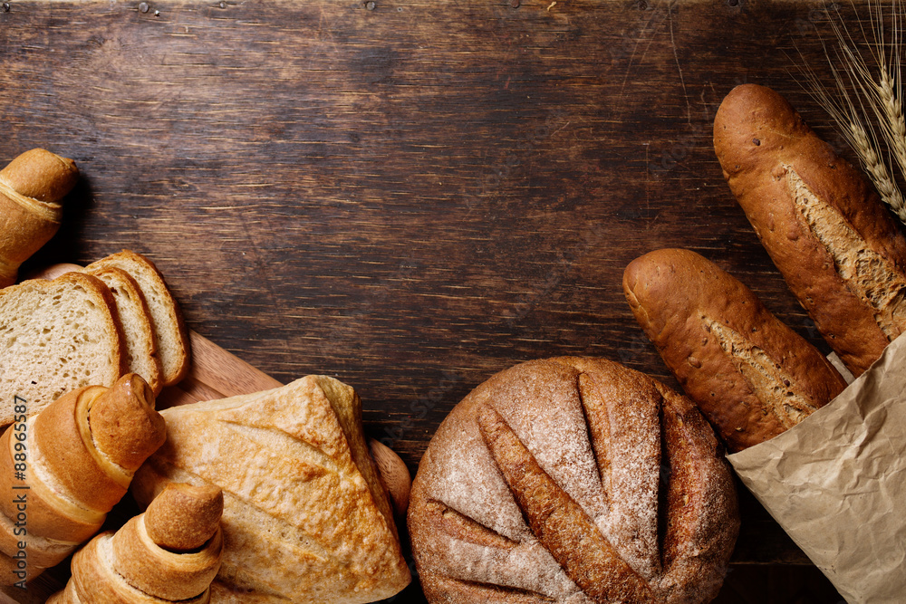 Different bread on a rustic dark background