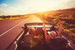 canvas print picture - Couple Driving Convertable at Sunset
