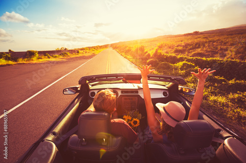 Couple Driving Convertable at Sunset - 88965997