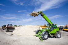 Construction Vehicles At Build...