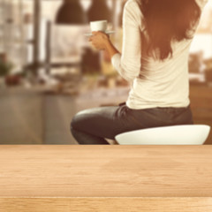 wooden desk space and woman with window sill
