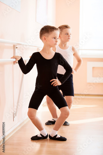 Young boys working at the barre in a ballet dance class. Plakát