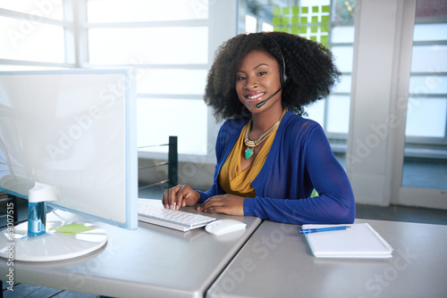 Portrait of a smiling customer service representative with an Fototapet