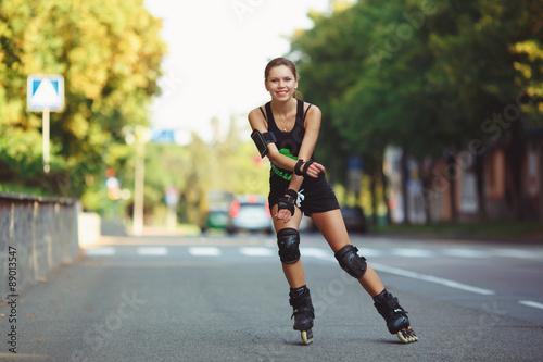 Cheerful girl on roller skates Fototapeta