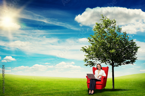Valokuva  woman sitting on the red chair