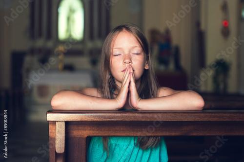 Fotografie, Obraz  Child praying in church