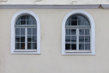Two Large, White Arched Window...