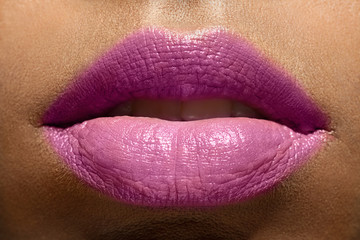 Closeup of beautiful woman lips purple