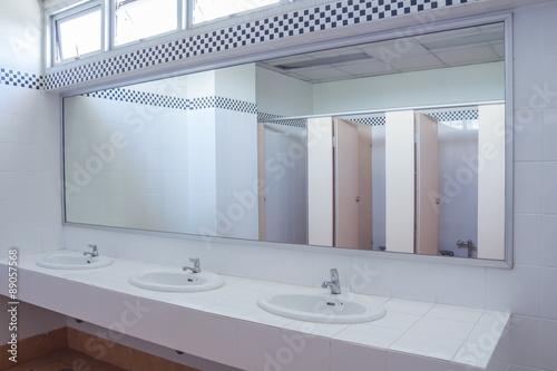 Obraz Bathroom at office.Handbasin and mirror in toilet - fototapety do salonu
