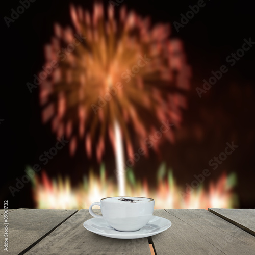Photo  Fireworks blur background and coffee on terrace wood