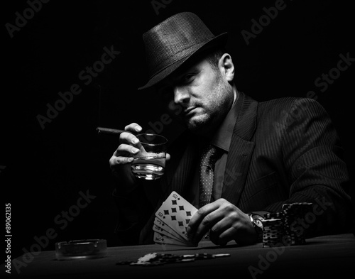 Male gambler playing poker and smokes a cigar, Black and white Tablou Canvas