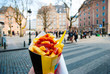 canvas print picture - Holding typical belgian fries in hand in Brussels