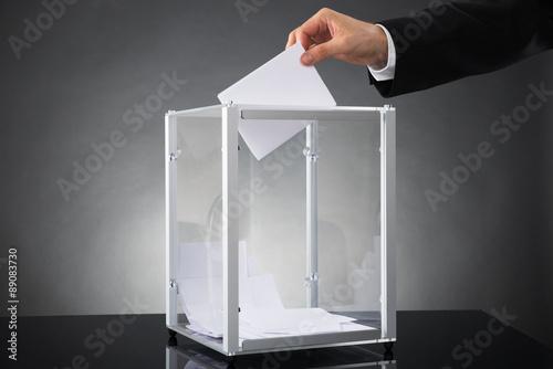 Valokuva  Businessperson Putting Ballot In Box