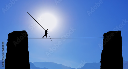 Foto Tightrope Walker Balancing on the Rope
