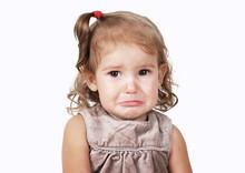 Portrait Of Sad Crying Baby Girl Isolated On White