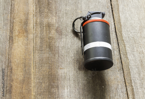 M18 Smoke grenade model on wood background - Buy this stock photo