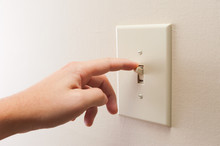 Hand Turning Wall Light Switch...