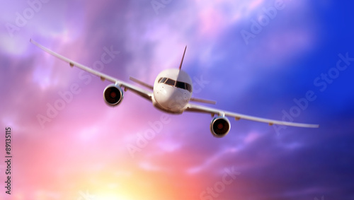 Passenger Airliner flying in the clouds Canvas Print