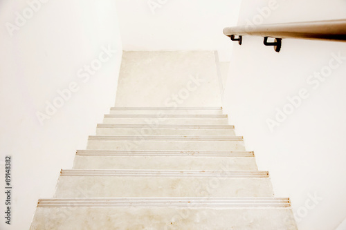 Photo Stands Stairs Cement stairs with wooden handrail