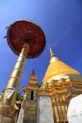 Pagodas with beep blue sky at Lampang, the north of thailand Wallpaper Mural