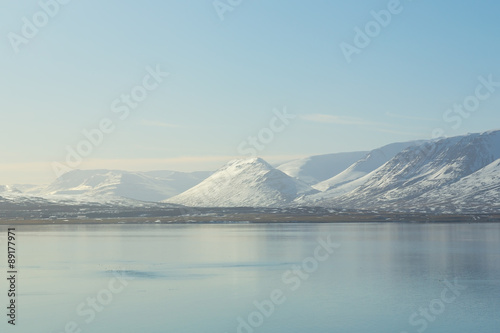 Tuinposter Lichtblauw Beautiful Sunshine over mountain snow with waterfront, Iceland