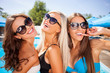 Cheerful young women are spending holidays with joy