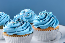 Blue Cupcakes With Silver Deco...