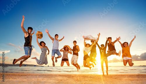 Obraz Group of friends jumping on beach - fototapety do salonu