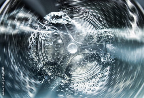 Fotografie, Obraz  Internal view of an empty washing machine drum during wash