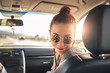 Girl Passenger in vehicle with sun shining