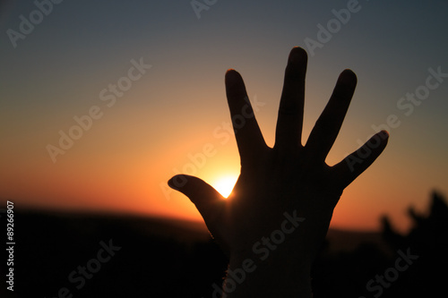Photo  Hand silhouette at sunset