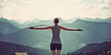 Woman Celebrating Nature And Reaching The Summit