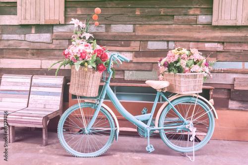 Foto op Plexiglas vintage bicycle on vintage wooden house wall on pastel colour